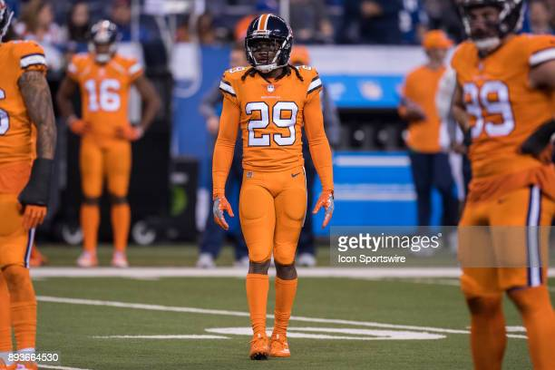 Denver Broncos cornerback Bradley Roby watches a video replay on the scoreboard during the NFL game between the Denver Broncos and Indianapolis Colts...