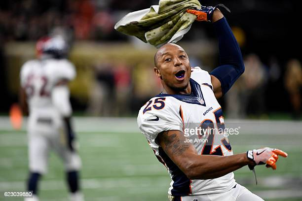 Denver Broncos cornerback Chris Harris celebrates the 2523 win over the New Orleans Saints at the MercedesBenz Superdome New Orleans LA Sunday...