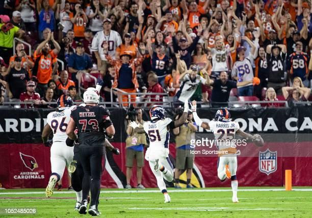 Denver Broncos cornerback Chris Harris gives Denver Broncos linebacker Todd Davis a high five during NFL football game between the Arizona Cardinals...