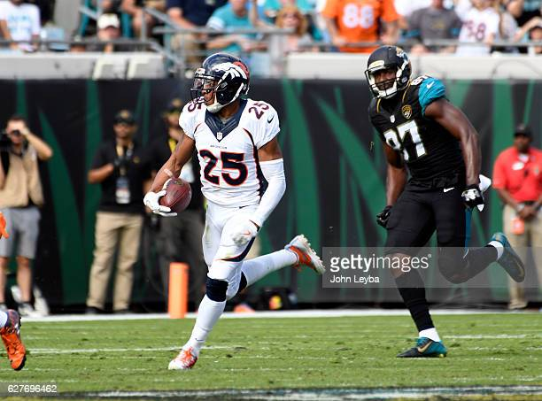 Denver Broncos cornerback Chris Harris heads up field after his interception on Jacksonville Jaguars quarterback Blake Bortles during the second...