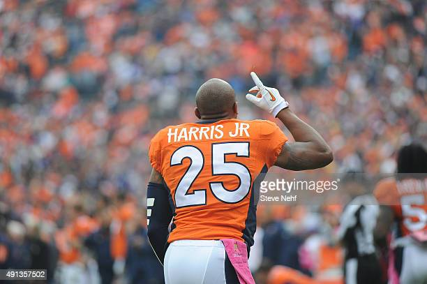Denver Broncos cornerback Chris Harris Jr points skyward before the game against the Minnesota Vikings at Sports Authority Field at Mile High on...