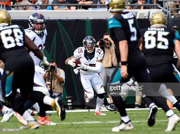 Denver Broncos cornerback Chris Harris looks up field after his interception on Jacksonville Jaguars quarterback Blake Bortles during the second...