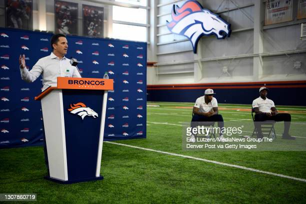 Denver Broncos cornerback Ronald Darby , and Broncos running back Mike Boone , listen to General Manager of the Denver Broncos George Paton , as he...