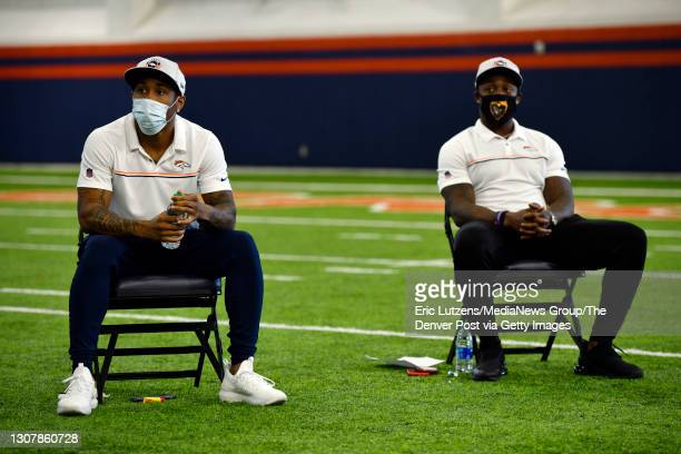 Denver Broncos cornerback Ronald Darby and Broncos running back Mike Boone listen to General Manager of the Denver Broncos George Paton as he...