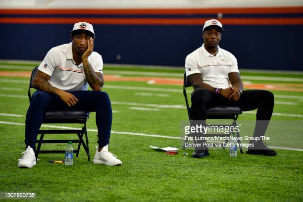Denver Broncos cornerback Ronald Darby and Broncos running back Mike Boone listen to General Manager of the Denver Broncos George Paton as he answers...