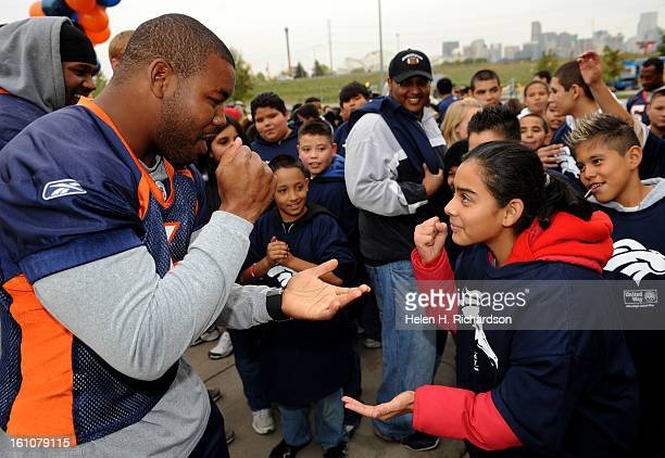 Denver Broncos Daryl Hackney left tries to beat Janely Altamirando at a game of Rock Scissors Paper or Ro Sham Bo before the start of the Fun Walk In...