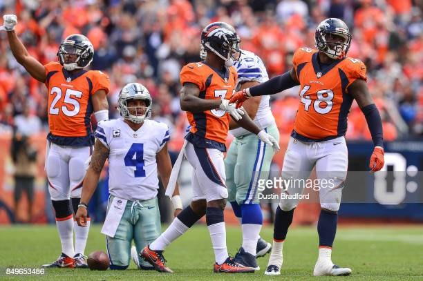 Denver Broncos defenders including Chris Harris Will Parks and Shaquil Barrett react after stopping quarterback Dak Prescott of the Dallas Cowboys...
