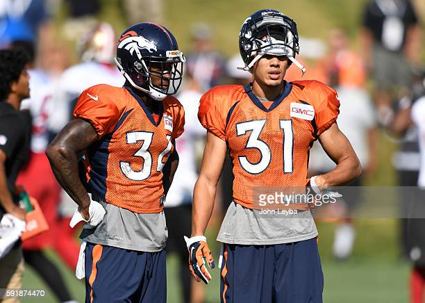 Denver Broncos defensive back Will Parks and Denver Broncos free safety Justin Simmons look on during practice August 18 2016 at Dove Valley