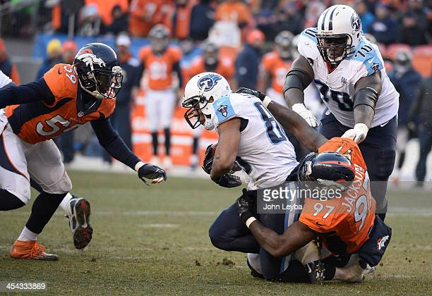 Denver Broncos defensive end Malik Jackson tackles Tennessee Titans tight end Visanthe Shiancoe in the second quarter The Denver Broncos take on the...