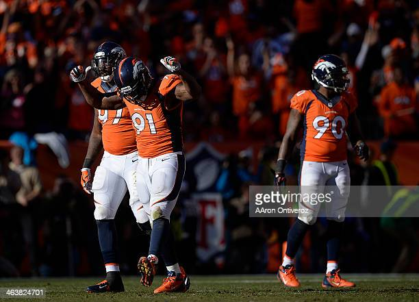 Denver Broncos defensive end Robert Ayers celebrates a sack in the second quarter. The Denver Broncos take on the New England Patriots in the AFC...