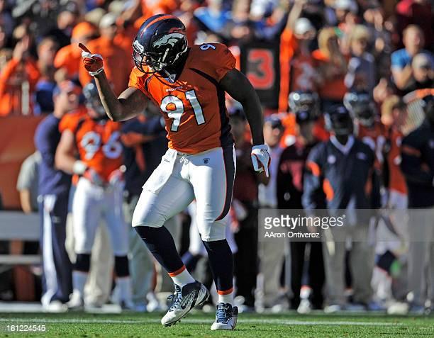 Denver Broncos defensive end Robert Ayers celebrates a sack on Detroit Lions quarterback Matthew Stafford during the second quarter of play Sunday...