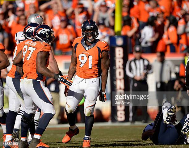 Denver Broncos defensive end Robert Ayers reacts to a play during the second quarter. The Denver Broncos vs. The New England Patriots in an AFC...