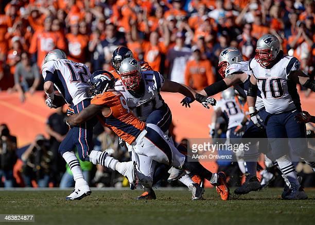 Denver Broncos defensive end Robert Ayers sacks New England Patriots quarterback Tom Brady on third down in the second quarter. The Denver Broncos...