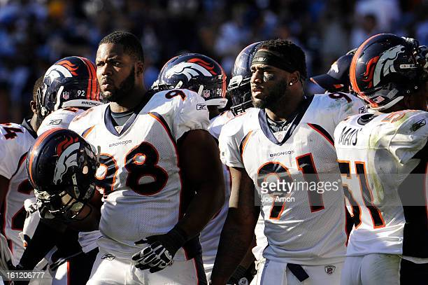 Denver Broncos defensive end Ryan McBean and defensive end Robert Ayers from the huddle against the San Diego Chargers at Qualcomm Stadium in San...