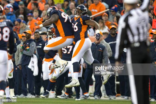 Denver Broncos defensive ends Shelby Harris and Zach Kerr celebrate during the New York Jets vs Denver Broncos football game at Sports Authority...