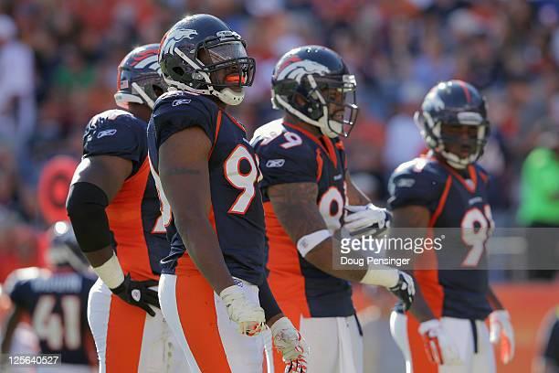 Denver Broncos defensive linemen Brodrick Bunkley, Jason Hunter, Kevin Vickerson, and Robert Ayers of the Denver Broncos prepare to defend the...