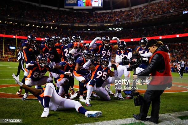 Denver Broncos defensive players celebrate after a second quarter turnover on a defensive back Dymonte Thomas interception during a game against the...
