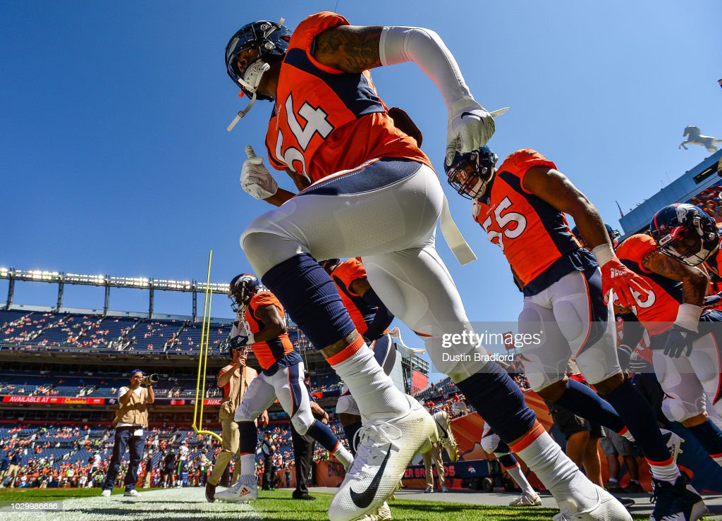 Denver Broncos defensive players including linebacker Brandon Marshall #54 run onto the field to warm up before a game against the Seattle Seahawks at Broncos Stadium at Mile High on September 9, 2018 in Denver, Colorado.