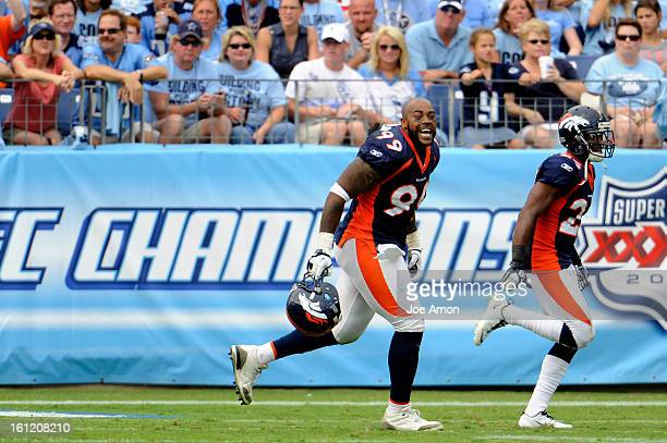 Denver Broncos defensive tackle Kevin Vickerson celebrates his fumble recovery in the second half of their game vs the Tennessee Titans at LP Field...