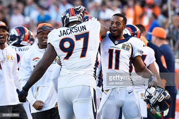 Denver Broncos defensive tackle Malik Jackson celebrates with wide receiver Jordan Norwood after he recovered a fumble in the end zone against the...