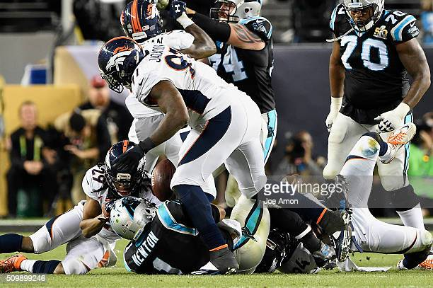 Denver Broncos defensive tackle Malik Jackson gets to Carolina Panthers quarterback Cam Newton for a sack with defensive end DeMarcus Ware in Super...