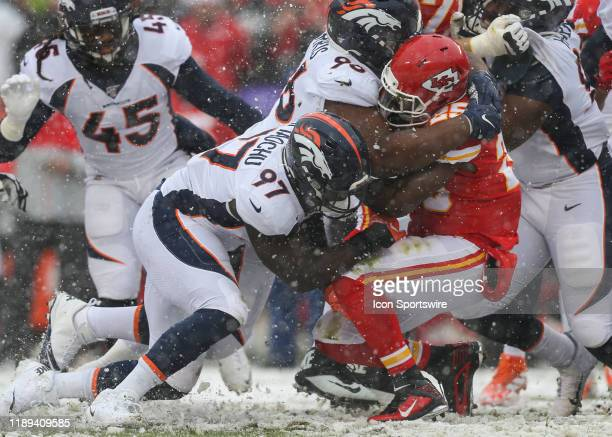 Denver Broncos defensive tackle Shelby Harris and linebacker Jeremiah Attaochu stuff the run attempt by Kansas City Chiefs running back LeSean McCoy...
