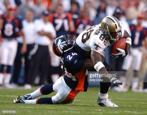 Denver Broncos Deltha O'Neal drags down Saints Willie Jackson during the first quarter It was the first game in the new Mile High stadium ANDY CROSS
