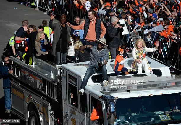 Denver Broncos DeMarcus Ware QB Peyton Manning Von Miller Mosley Manning and Annabel Bowlen ride atop Denver Fire truck during the Denver Broncos...