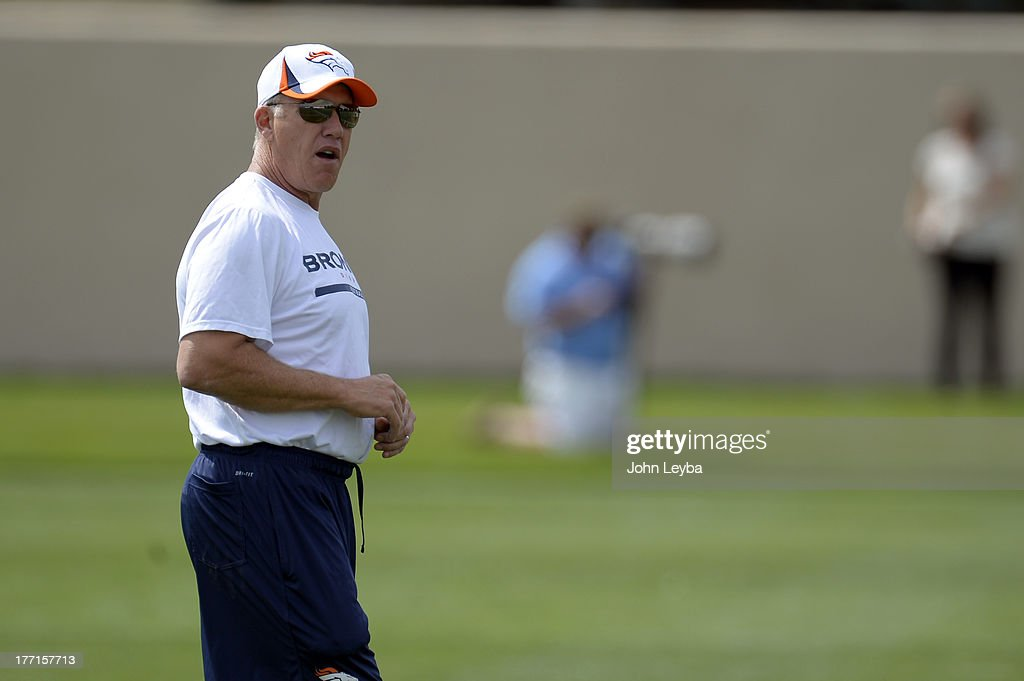 Denver Broncos Executive VP of Football Operations John Elway looks on during practice August 22, 2013 at Dove Valley