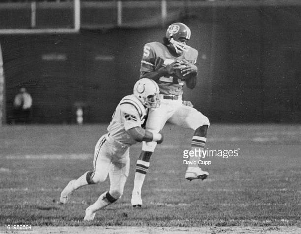 AUG 8 1975 AUG 10 1975 Denver Broncos Exhibition Game Denver Pass dents colts defense Wide receiver Haven Moses of Denver hauls in a pass from John...