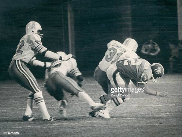 AUG 8 1975 AUG 10 1975 Denver Broncos Exhibition Game Teammates gettogether turns into unhappy meeting Quarterback John Hufnagel of Denver lunges for...