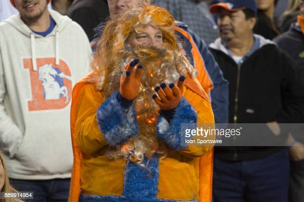 Denver Broncos fan cheers during the New York Jets vs Denver Broncos football game at Sports Authority Field in Denver CO on December 10 2017