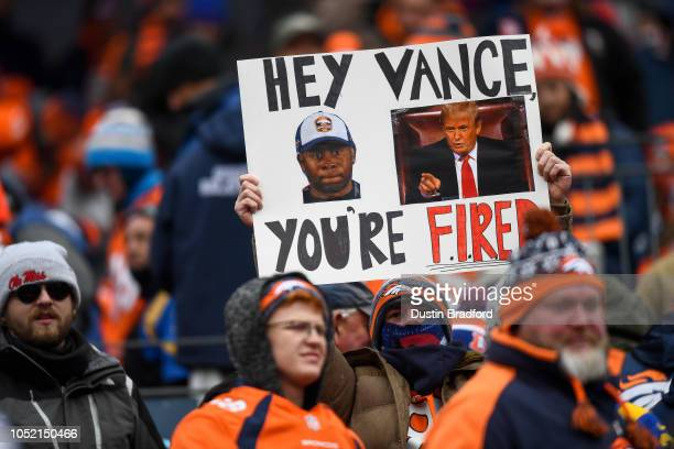 Denver Broncos fan holds a sign asking for the firing of head coach Vance Joseph of the Denver Broncos during a game between the Denver Broncos and...