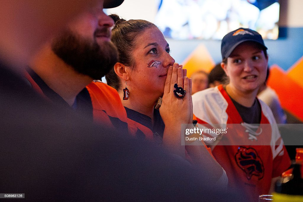 Denver Broncos fan Lauren Fisher watches Super Bowl 50 at Declaration Brewing Company on February 7, 2016 in Denver, Colorado.