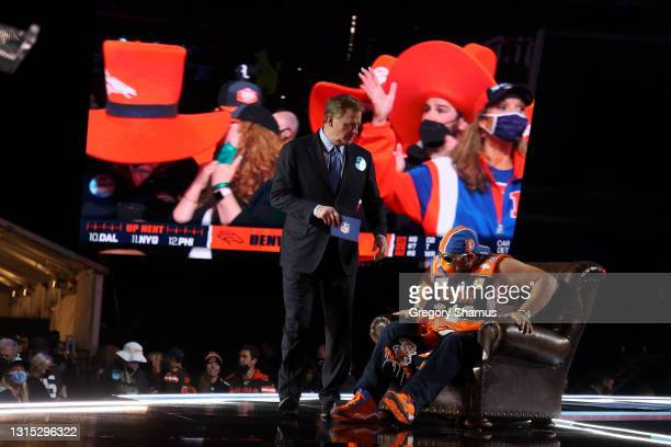 Denver Broncos fan speaks with NFL Commissioner Roger Goodell onstage during round one of the 2021 NFL Draft at the Great Lakes Science Center on...