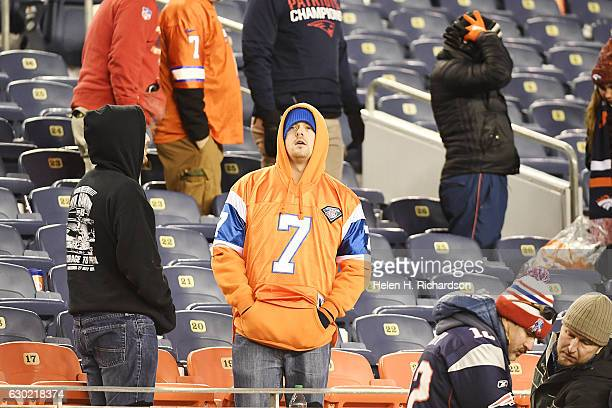 Denver Broncos fan stands in disappointment during the fourth quarter of the Patriots' 163 win on Sunday December 18 2016 The Denver Broncos hosted...
