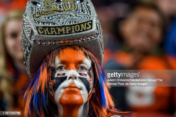 Denver Broncos fan Will Ash shows signs of frustration as the Broncos trail the Kansas City Chiefs during the fourth quarter of Kansas City's 30-6...