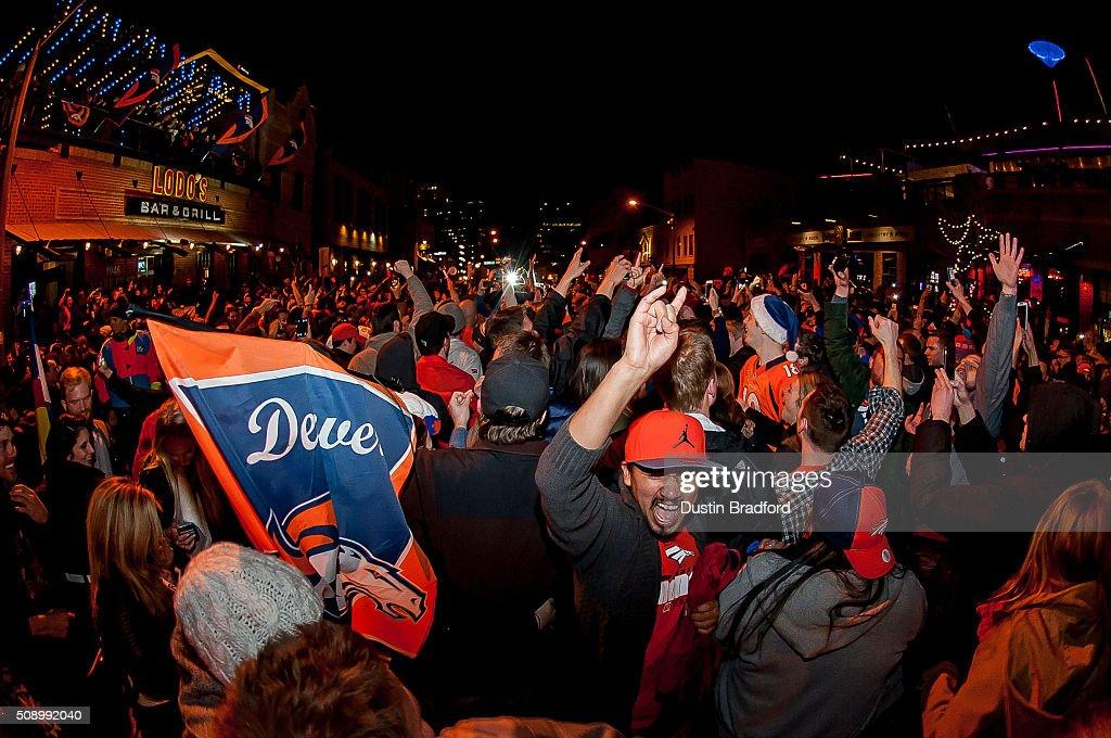 Denver Broncos fans celebrate in the street after the Denver Broncos won Super Bowl 50 on Market Street in Lower Downtown on February 7, 2016 in Denver, Colorado.