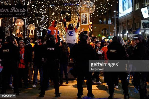 Denver Broncos fans celebrate the Super Bowl victory over the Carolina Panthers in Downtown Denver February 07 2016