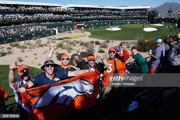Denver Broncos fans cheer as golfers play on the16th hole during the third round of the Waste Management Phoenix Open at TPC Scottsdale on February 6...