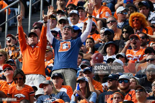Denver Broncos fans go bananas in the upper deck as they cheer their team on against the Dallas Cowboys during the second quarter on Sunday September...