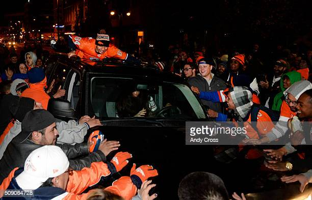 Denver Broncos fans rock an SUV back and forth during a Super Bowl 50 celebration near the 16th St Mall February 07 2016