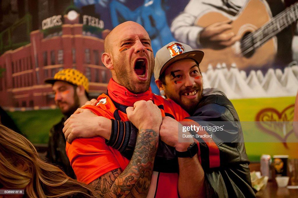 Denver Broncos fans watch Super Bowl 50 at Cheba Hut on February 7, 2016 in Denver, Colorado.