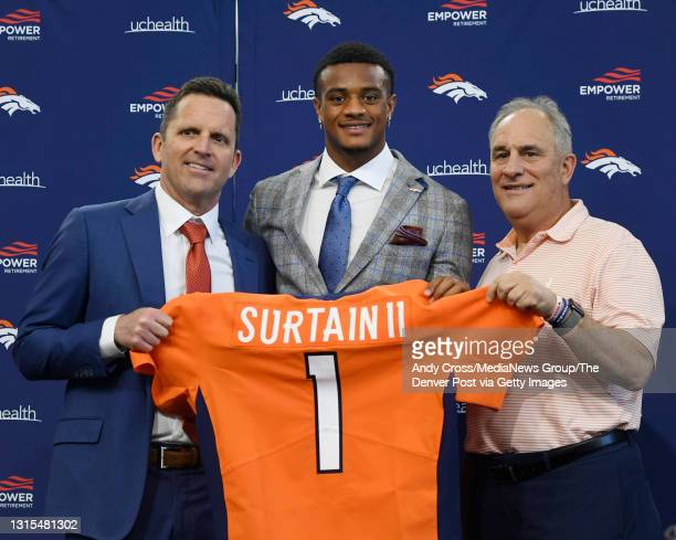 Denver Broncos first round draft pick, Patrick Surtain II, center, poses with GM George Paton, left, and head coach Vic Fangio after his introductory...