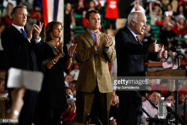 Denver Broncos former quarterback John Elway and his fiancee Paige Green and former Broncos player John Lynch listen to Republican presidential...