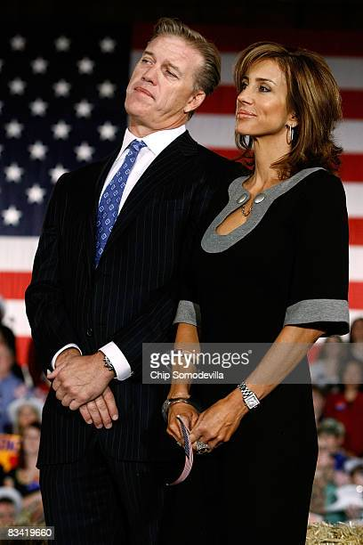 Denver Broncos former quarterback John Elway and his fiancee Paige Green listen to Republican presidential nominee Sen John McCain during a campaign...