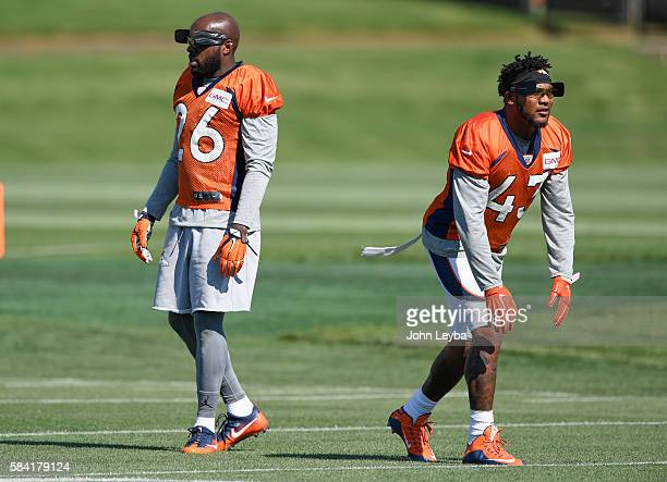 Denver Broncos free safety Darian Stewart and Denver Broncos strong safety TJ Ward wear a pair of blinders training tool in drills during practice on...