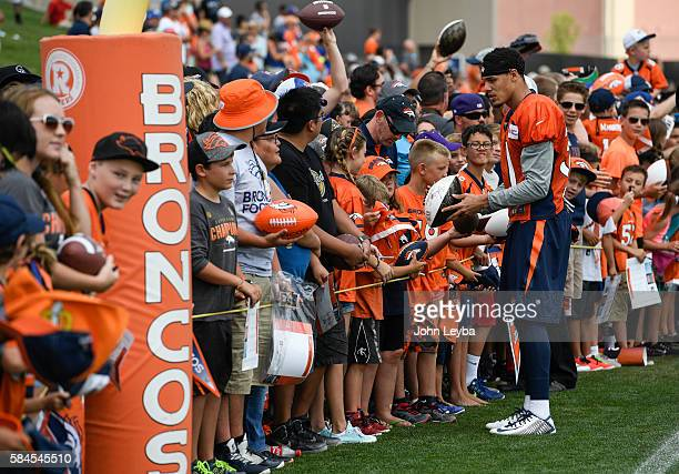 Denver Broncos free safety Justin Simmons signs autographs for fans after practice July 29 2016 during day 2 of training camp July 29 2016 at Dove...