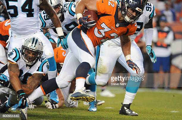 Denver Broncos fullback Andy Janovich breaks loose for a touchdown in the second quarter against thee Carolina Panthers at Sports Authority Field at...