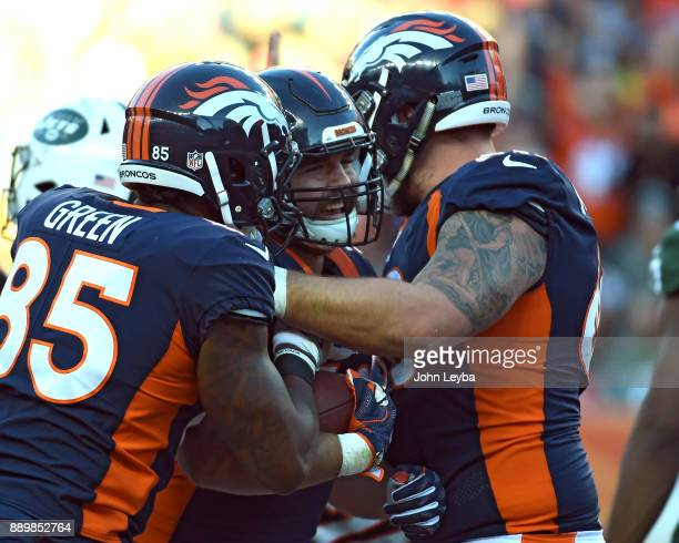 Denver Broncos fullback Andy Janovich celebrates his touchdown with tight end Virgil Green and offensive guard Connor McGovern during the third...